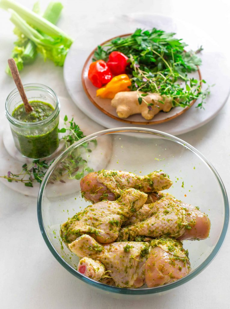 raw chicken marinated in Caribbean green seasoning