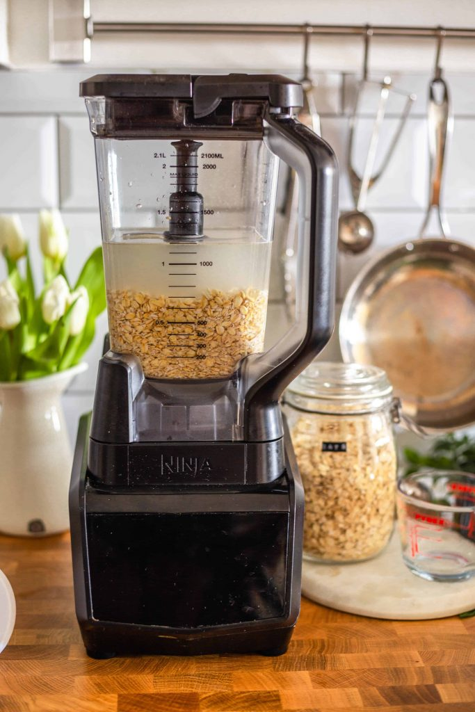 oats in a blender with water for the oat milk