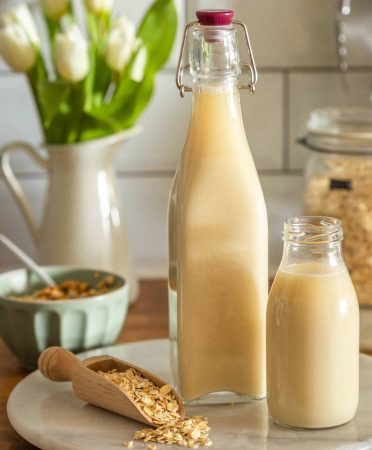 homemade oat milk in bottles and jumbo oats