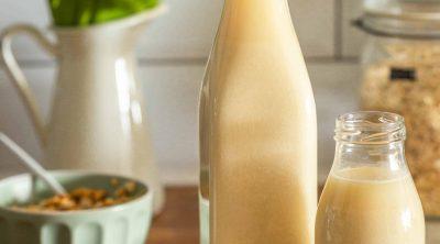 homemade oat milk in bottles and jumbo oats
