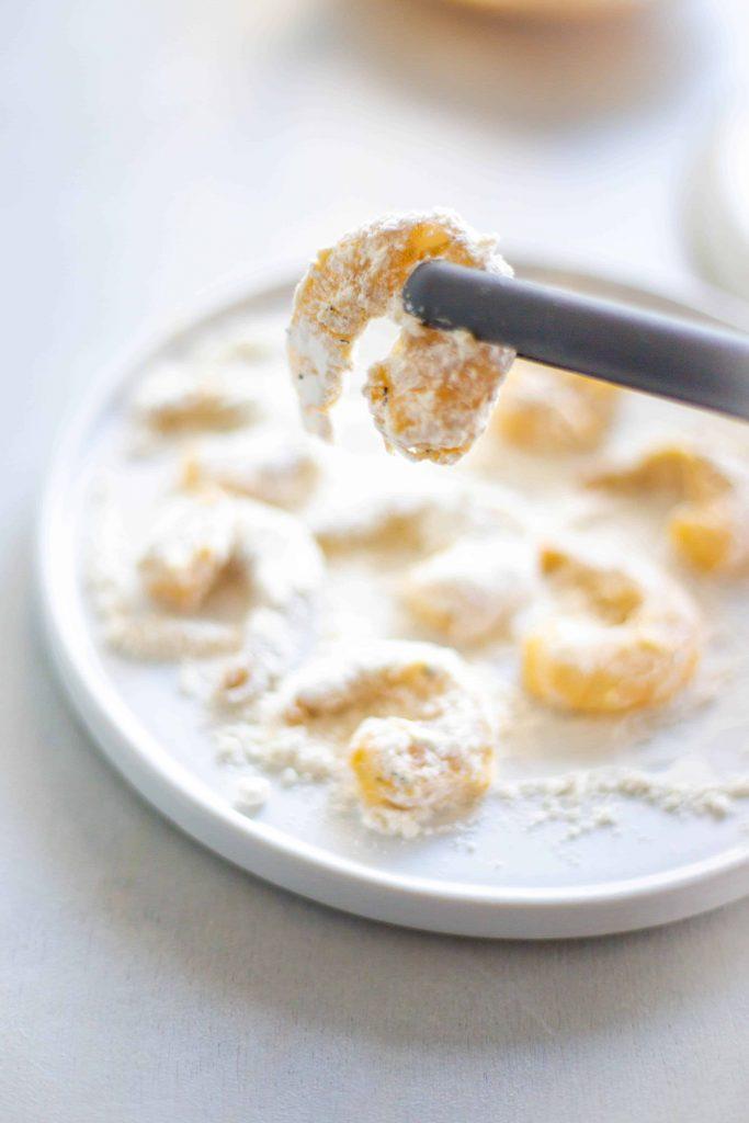raw shrimp in flour dredge