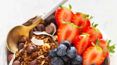chocolate granola and fruit in a bowl