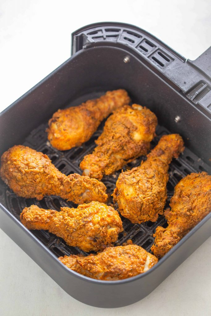 cooked kfc chicken in the air fryer basket