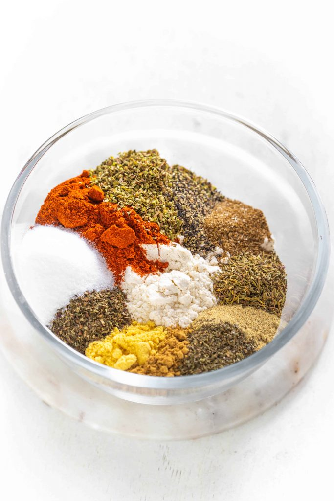 spices and herbs in a bowl for the kfc seasoned flour