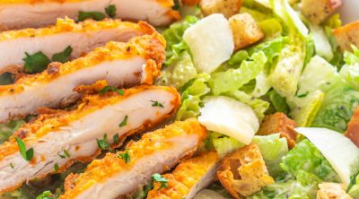 chicken caesar salad in a bowl