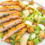 Air Fryer Crispy Chicken Caesar salad in a bowl