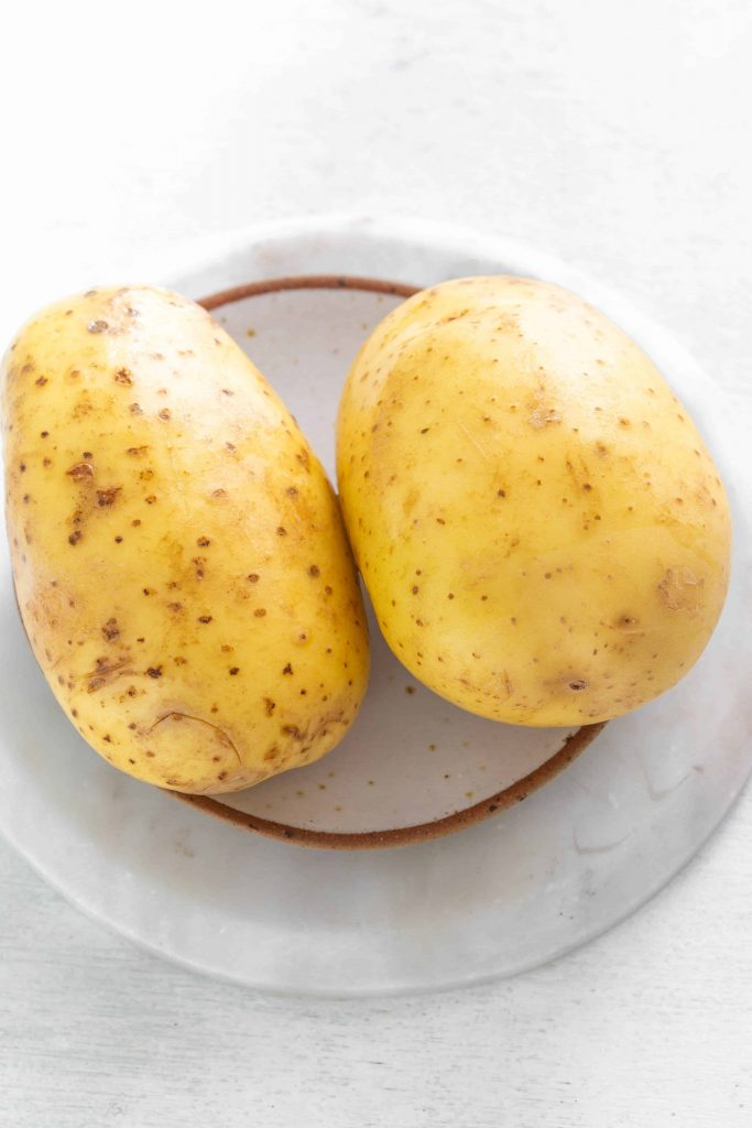 two potatoes on a plate