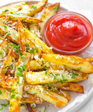 garlic parmesan truffle fries with ketchup sauce on the side