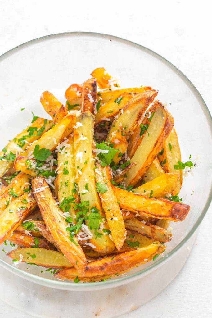 mixed garlic parmesan truffle seasoning on the air fried fries chips