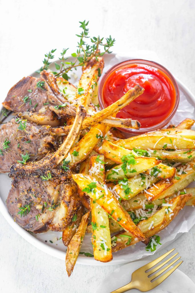 air fryer lamb chops on a plate with truffle fries and ketchup