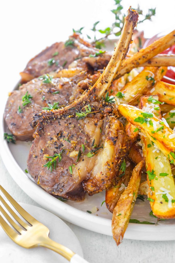 air fryer lamb chops on a plate with fries