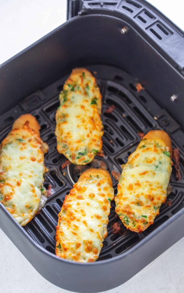 Air Fryer Cheesy Garlic Bread in an air fryer basket